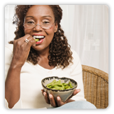 Photo of a woman holding a bowl of food